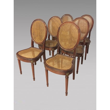 Six Louis XVI style caned chairs